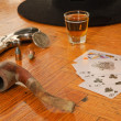 Whiskey, cards and gun on a floor — Stock Photo #30505889