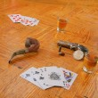 Whiskey, cards and gun on a floor — Photo