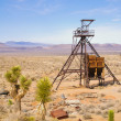 Ghost town mining shaft head — Stock Photo