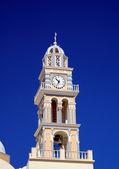 Church bellfry with clock on Santorini island — Stock Photo