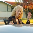 Business woman gets into her car — Stock Photo
