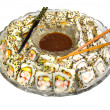 Sushi rolls on a platter with soy sauce — Stock Photo