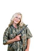 Smiling woman with black powder revolver — Stock Photo