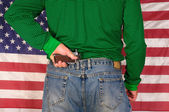 Man standing in front of a US flag — Stock Photo