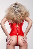 Woman in sexy red corset — Stock Photo