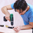Carpenter with drill — Stock Photo