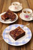 Cherry brownie with black tea — Stock Photo