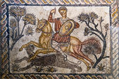 Roman mosaic of a man on a horse hunting — Stock Photo