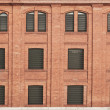 Stock Photo: Old orange brick wall with windows