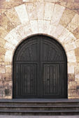 Old ornate wooden doors in Valladolid, Spain. — Stock Photo