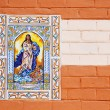 Virgin Mary Ceramic Image over paint wall — Stock Photo #21681837