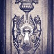 Figures carved door , with knocker, black & white — Stock Photo