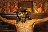 Jesus on the cross, carved in polychrome wood — Stock Photo