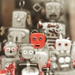 Single robot, standing out among the mass of robots - Stock Photo