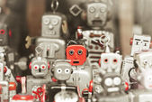 Single robot, standing out among the mass of robots — Stock Photo
