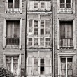 Facade of old building in ruins, black and white — Stock Photo