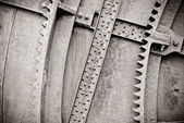 Background old machine with gears and rivets, black and white — Stock Photo