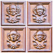 A set of four faces expressing different emotions over wood — Stock Photo