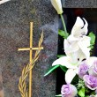 Tombstone with cross and flowers — Stock Photo #14772649