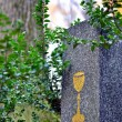 Tombstone with golden chalice — Stock Photo