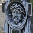 Stock Photo: Head of Christ carved in cross