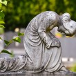 Statue of a praying Madonna — Stock Photo