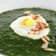 Green soup in white dish — Stock Photo