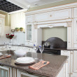 Bright brand new european kitchen - Stock Photo