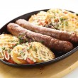 Roasted sausages with potato — Stock Photo