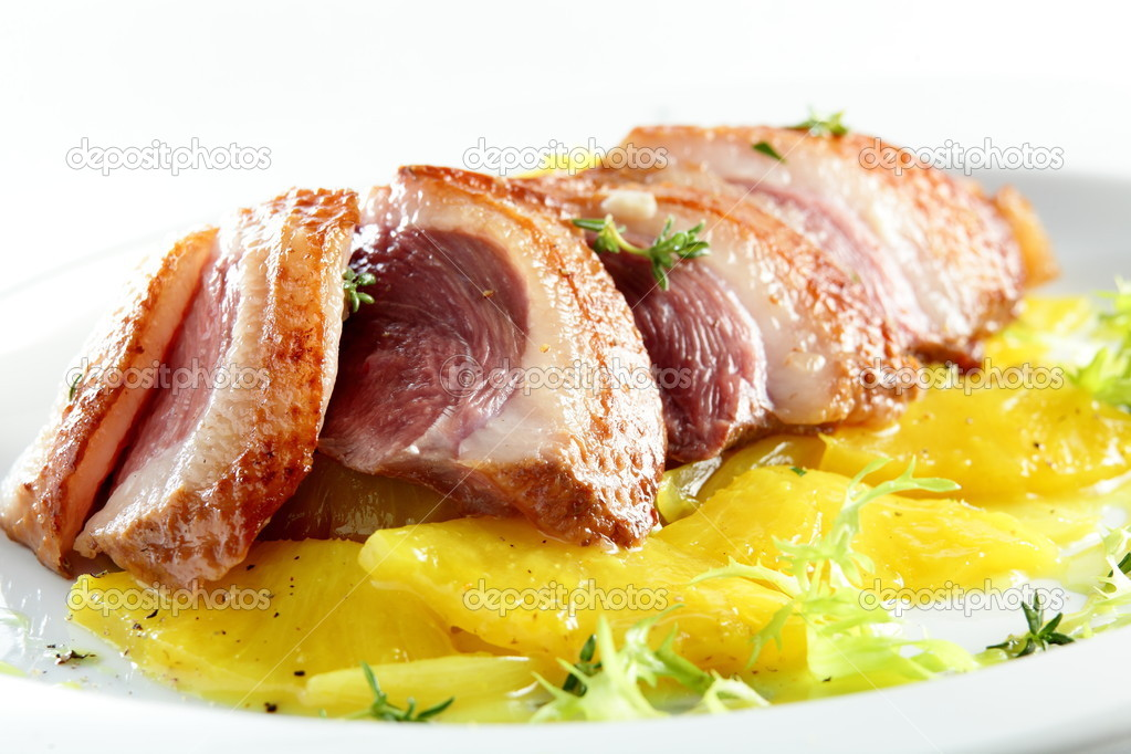 Hot roasted meat with garnish from pineapple — Stock Photo #17392193