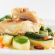 Peace of fish with garnish — Stockfoto