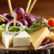 Stock Photo: Wooden dish with cheese and fruits