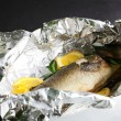 Peace of roasted fish - Stock Photo
