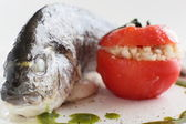 Big fish with tomato — Stock Photo