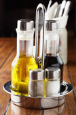 Bottles with oil and salt and pepper — Stock Photo