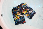 Funny swimming trunks on a water — Stock Photo