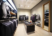 Modern and fashion clothes store — Stock Photo