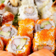 Tasty japanese sushi on white dish — Stock Photo