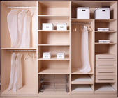 Nice interior of wooden wardrobe — Stock Photo