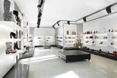 Luxury shoe store with bright interior — Stok fotoğraf