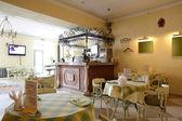 European restaurant in yellow colors — Stock fotografie