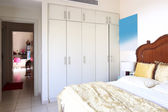 Nice interior of european bedroom — Stock Photo