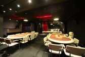 Dark and fashionable casino with tables — Stockfoto