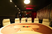 Dark and fashionable casino with tables — Stock Photo