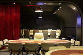 Dark and fashionable casino with tables — Stok fotoğraf