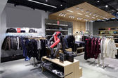 Brand new interior of cloth store — Stok fotoğraf