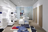 Brand new interior of cloth store — Стоковое фото