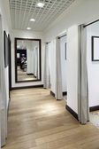 Interior of dressing room at cloth store — Stock Photo