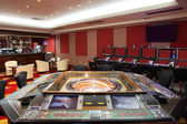 Bright and fashionable casino with tables — Stock Photo