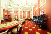 Bright and fashionable casino with tables — Stockfoto